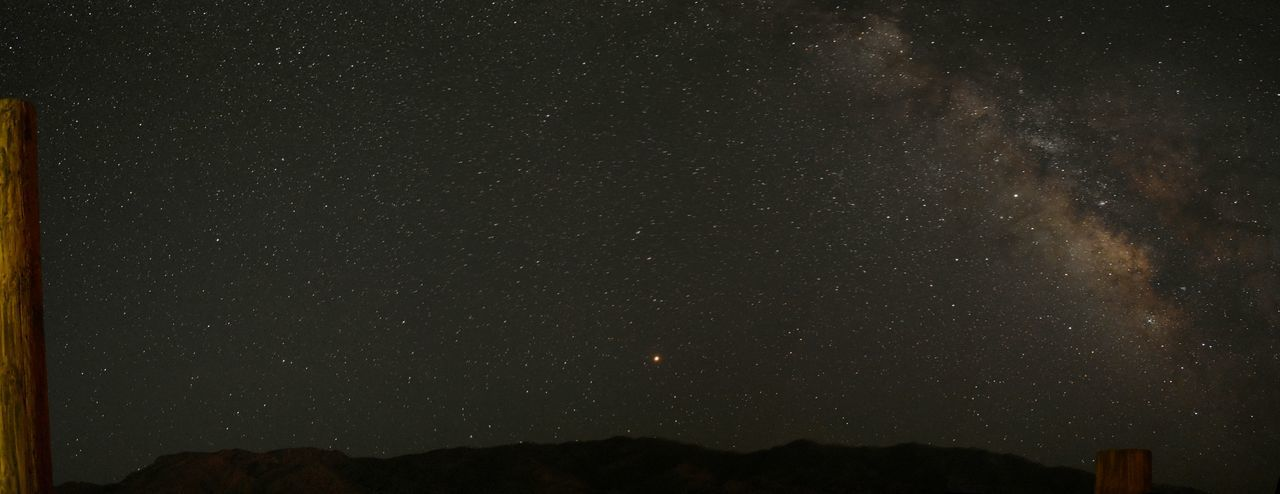 Low angle view of star field against sky at night