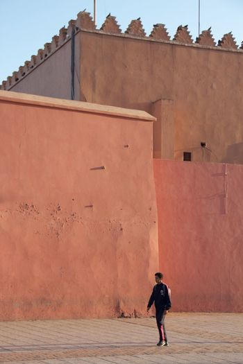 Architecture Architecture Back Backpacking Building Building Exterior Built Structure Casual Clothing City Life Colours Contrast Day Full Length Leisure Activity Lifestyles Morocco Outdoors Perspective Sky Tradditional Traditional