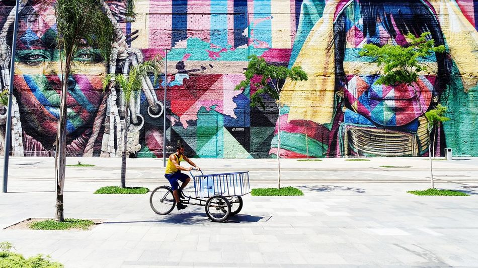 in Rio EyeEm Best Shots EyeEmNewHere Street Photography The Week on EyeEm Graffiti Art Graffiti Wall Building Exterior EyeEm Selects Mobility In Mega Cities Graffiti Bicycle Multi Colored Day Outdoors Built Structure No People Architecture City Colour Your Horizn