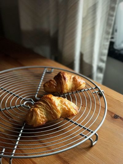 High angle view of croissants on cooling rack