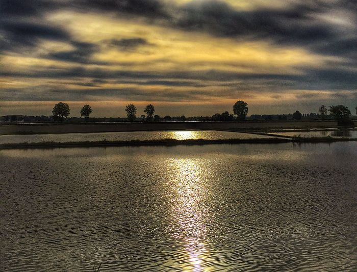 Sky Water Cloud - Sky Sunset Reflection Nature Scenics - Nature Beauty In Nature Tranquility Tranquil Scene No People Idyllic Dramatic Sky Outdoors Sunlight Waterfront