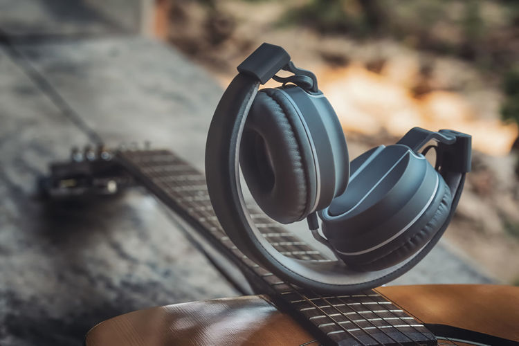 Music of life. Acoustic Audio Desk Earphones Headphones Music Nature Relaxing Rustic Sound Sound of Life Albums Auditory Countryside Equipment Guitar High Angle View Lifestyles Musician Photography Themes Popular Song Technology Vintage Wooden