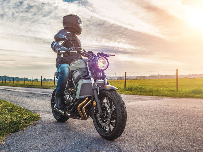Adult Adventure Beautiful Beautiful Nature Beauty In Nature Biker Crash Helmet Full Length Headwear Helmet Landscape Motivation Motorcycle One Man Only Outdoors People Riding Road Road Trip Spring Springtime Sunlight Sunset Transportation Travel