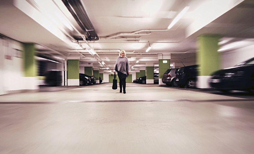Woman walking in parking garage