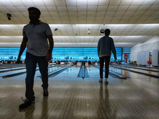 Eyeem Bowln' // Rear View Real People Full Length Men Walking Indoors  Casual Clothing Two People Standing Leisure Activity Lifestyles Illuminated Women Day Adult People Adults Only Google Pixel Bowling F/2.0 via Fotofall