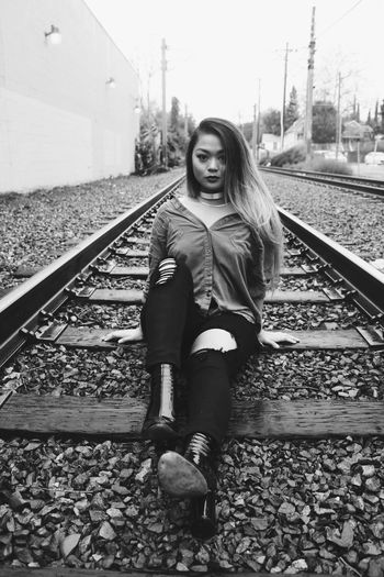 Portrait of woman on railroad track
