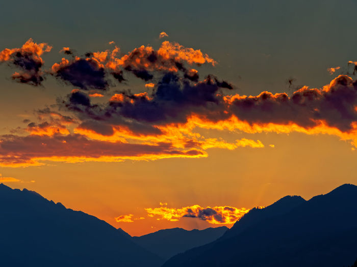 Sunset Beauty In Nature Sky Scenics - Nature Orange Color Mountain Cloud - Sky Tranquil Scene Tranquility Silhouette Mountain Range Idyllic Nature No People Dramatic Sky Non-urban Scene Majestic Outdoors Environment Awe Mountain Peak Romantic Sky