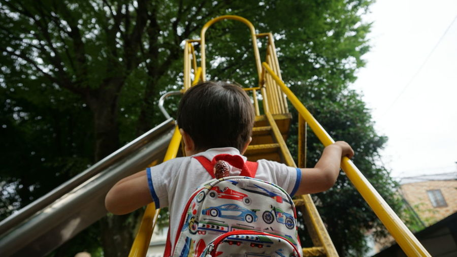 The Secret Spaces Myownspace Mysecretplace Playground One Person Childhood Tree People Outdoors Outdoor Play Equipment Day ChildChildren Only Slide Slide - Play Equipment Strong Kid Never Give Up Keep Climbing Resist Art Is Everywhere EyeEmNewHere