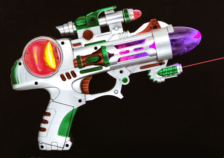 old toy ray gun on black Abstract Photography Retro SiFi Toys Creativity Gun Handgun High Angle View Indoors  Isolated On Black Multi Colored Multi Coloured Plastic Ray Gun Single Object Still Life Studio Shot Toy Toy Gun Weapon