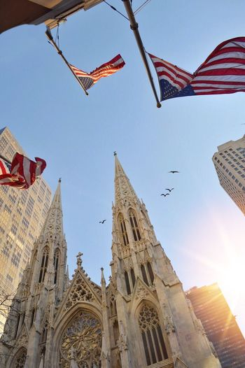 New York City New York Flag Architecture Low Angle View Religion Building Exterior Built Structure Day Spirituality Outdoors Place Of Worship No People Flying Patriotism Sky USA USA FLAG NYC NYC Photography