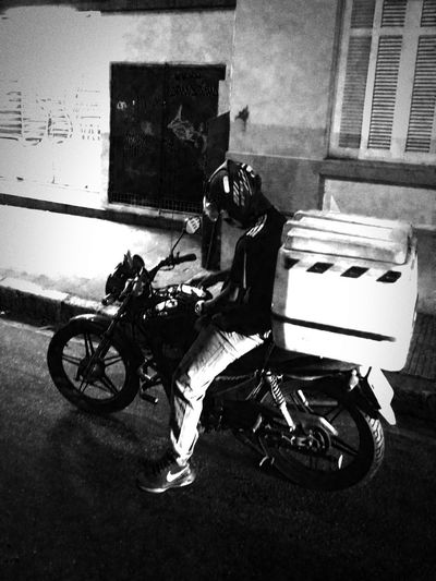 A man on a motorbike checking his phone. Land Vehicle Transportation One Person Real People Mode Of Transport One Man Only Motorcycle Full Length Outdoors Lifestyles Architecture Adult Black And White Monochrome Grey Contrast Night Dramatic Driving Riding Road Street Latin America South America City Life