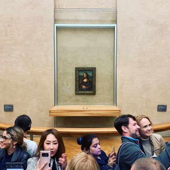 Distracted by technology Mona Lisa Art Group Of People Men Architecture Adult Young Men Young Adult Women Medium Group Of People Smiling Young Women