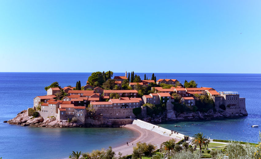 Sveti Stefan islet - luxury private hotel Budva Islet SvetiStefan Adriatic Sea Architecture Built Structure Exclusive Hotel Fort History Horizon Islet Hotel Luxuryhotel Montenegro Nature No People Private Hote Water