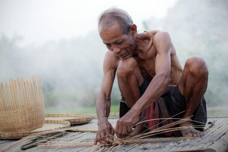 Senior Man Making Wicker Baskets