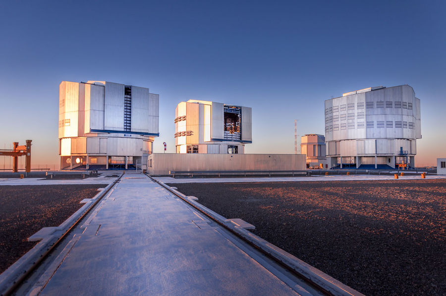 The worlds most powerful telescopes in Paranal, Chile Chile Architecture Astronomy Building Exterior Built Structure Clear Sky Day Eso Factory Industry No People Outdoors Paranal Researcher Sky Skyscraper Telescope Transportation