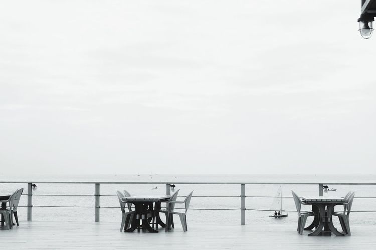 Empty chairs in the sea