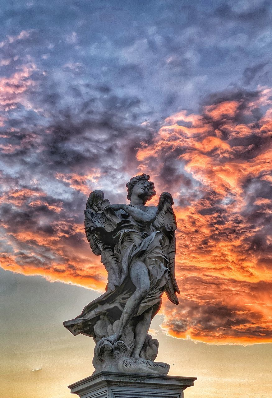 cloud - sky, sunset, sky, sculpture, art and craft, orange color, representation, statue, human representation, nature, no people, creativity, male likeness, craft, low angle view, architecture, beauty in nature, outdoors, female likeness