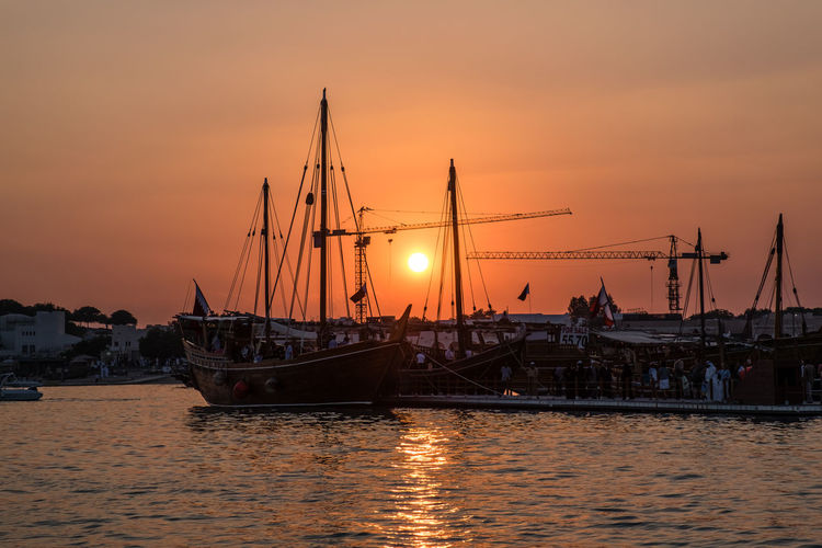 Traditional Bearings Festival, Doha, Qatar for fishing and pearl Katara Cultural Village Qatar Doha,Qatar Cultures Culture Hertitage Travel Tourism Arab Gulf Nautical Vessel Sunset Transportation Water Beauty In Nature Reflection Fishing Industry Nature Sun Outdoors Sea
