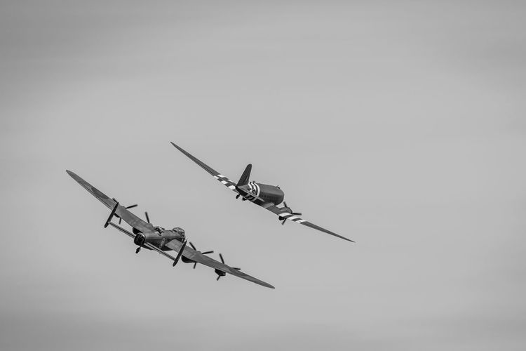 Lancaster Bomber and Dakota Lancaster Bomber Dakota  Old Planes War FlyBy Air Display  Air Vehicle Airplane Flying Military Mode Of Transportation Sky on the move Plane Low Angle View Mid-air Fighter Plane Aerospace Industry