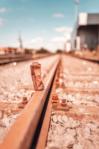 Close-up of rusty spray can on railroad track