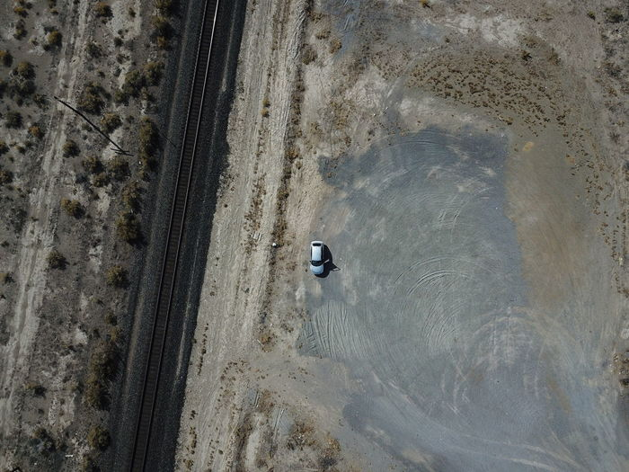 Aerial view of car by railroad track