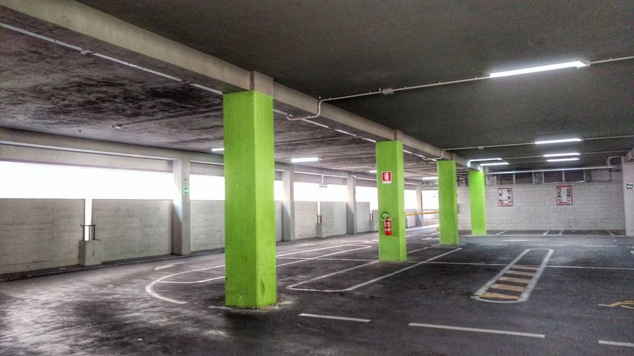 Parking... Parking Garage Building No People The Still Life Photographer - 2018 EyeEm Awards The Street Photographer - 2018 EyeEm Awards The Architect - 2018 EyeEm Awards Triest Italy EyeEm Selects Park City Illuminated Architectural Column Ceiling Parking Lot Architecture Built Structure Walkway Cement