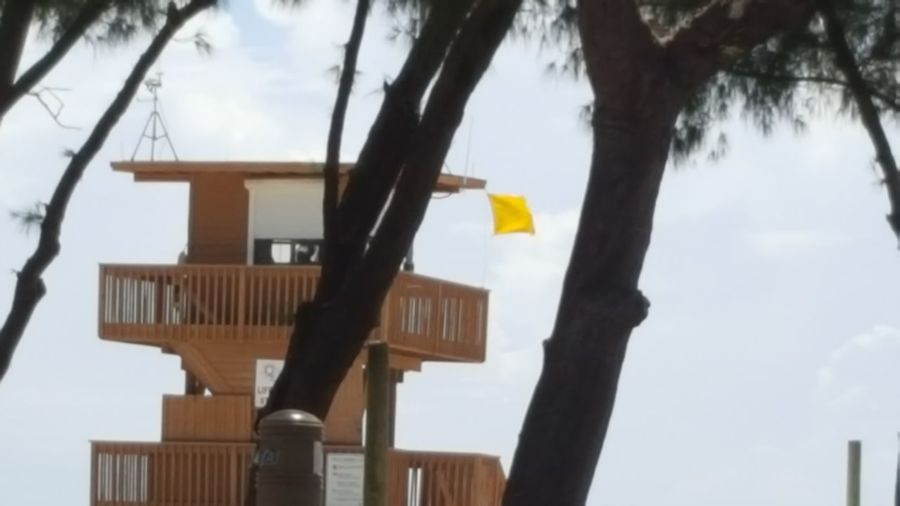 Yellow flag on lifeguard tower Yellow Flag Lifeguard Tower Flapping In The Wind Warning Be Safe Florida Afternoon Florida Summertime Florida Life After The Storm Gulf Of Mexico Anna Maria Island