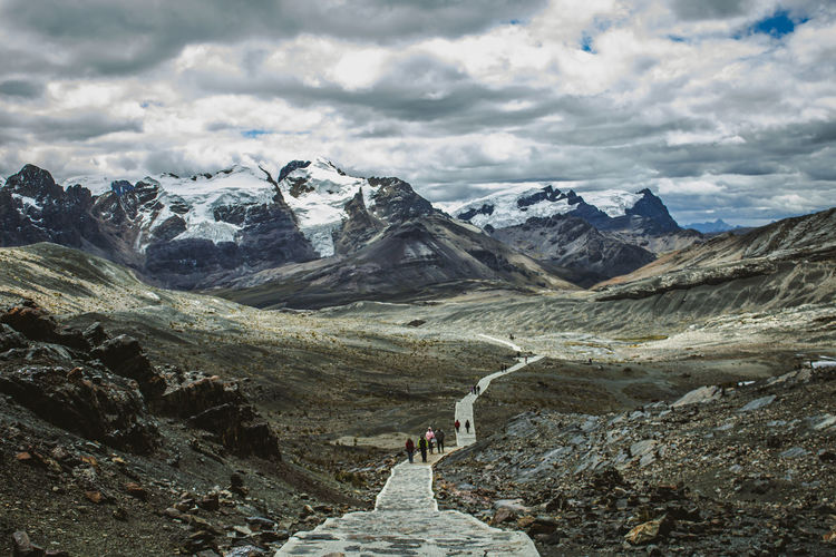 Landscape of the road back and chain of mountains in front of pastoruri glacier