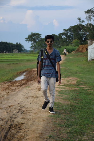 Traveling Home For The Holidays Confidence  One Person Sunglasses Full Length Leisure Activity Front View One Man Only Only Men Outdoors Day Sport People Adults Only Adult Young Adult Sky Advanture Gress Field Fashionphotography Fashionstyle Travelingtheworld  Traveling Photography Traveling India