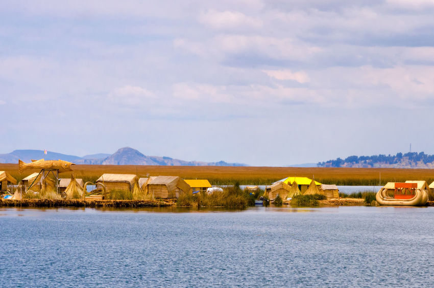 View of the manmade floating islands near Puno, Peru Architecture Beach Colorful Ethnic Floating Houses Inca Isla Island Islands Lake Landscape Manmade Peru Puno Puno, Perú Scene Scenics Titicaca Titicaca Lake Totora Tourism Uros Uros Island Water