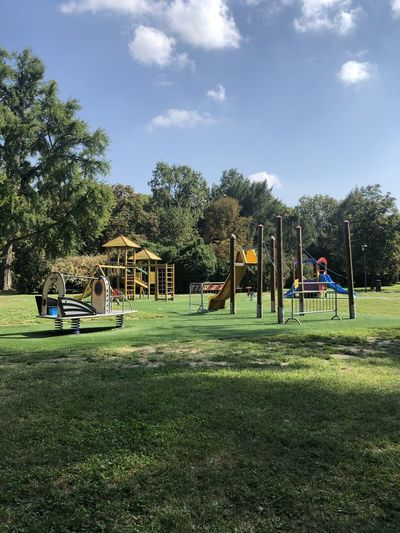 Playground in park against sky