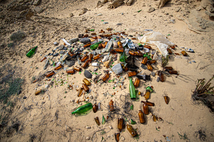 High angle view of garbage on sand
