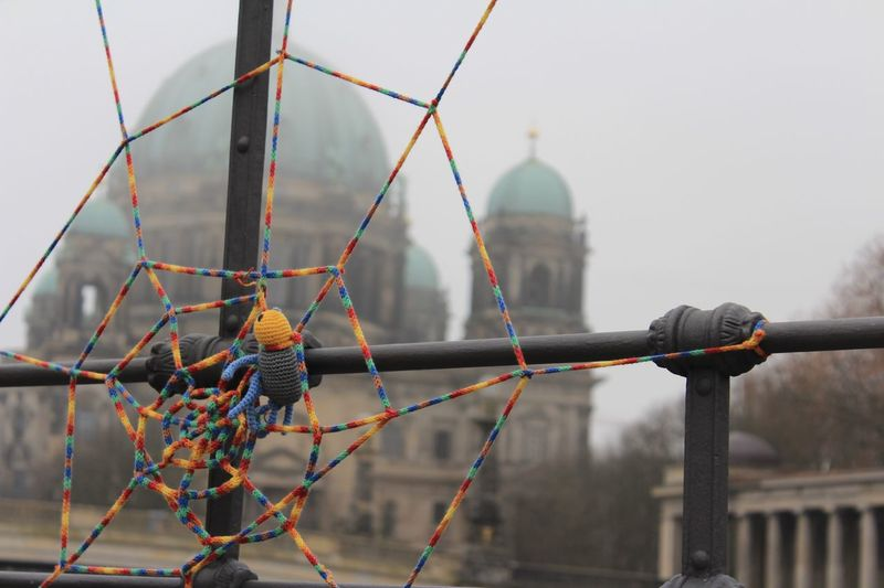 Decoration on railing against berlin cathedral during foggy weather