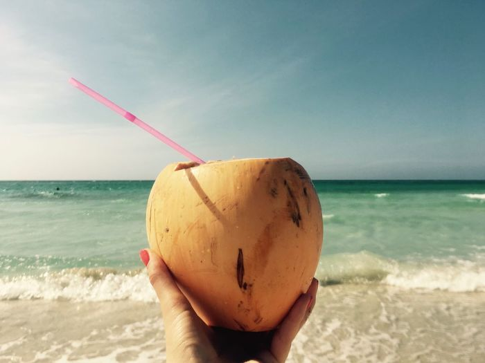Beach Beauty In Nature Close-up Coconut Cuba Drink Drinking Straw Food Food And Drink Freshness Healthy Food Holding Horizon Over Water Human Hand In My Hand Medical Nature Ocean Outdoors Personal Perspective Sea Tropical Fruits Tropical Paradise Vacation Water