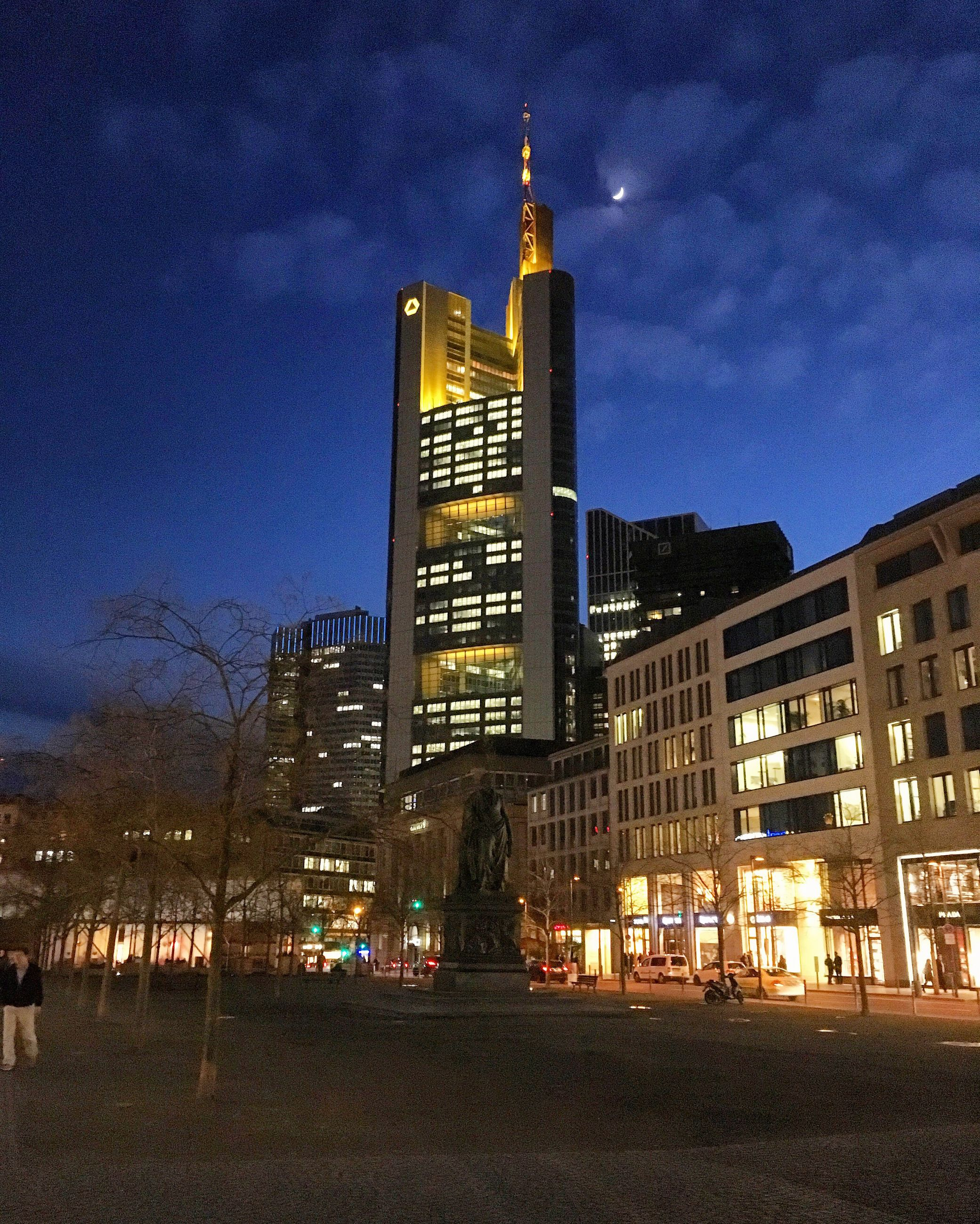 architecture, building exterior, built structure, illuminated, city, sky, tower, night, tall - high, skyscraper, dusk, building, modern, travel destinations, sunset, street, capital cities, city life, low angle view, office building
