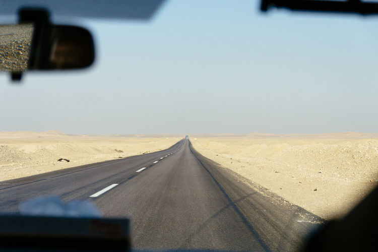 Highway through the Eastern Desert, Egypt Africa Beauty In Nature Desert Deserts Around The World Egypt Journey Landscape Mode Of Transport Nature Road The Way Forward Tranquility Travel Travel Destinations Travel Photography Traveling Vanishing Point Neighborhood Map