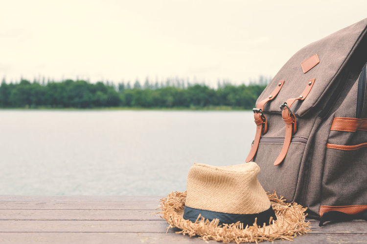 Close-up of backpack and hat