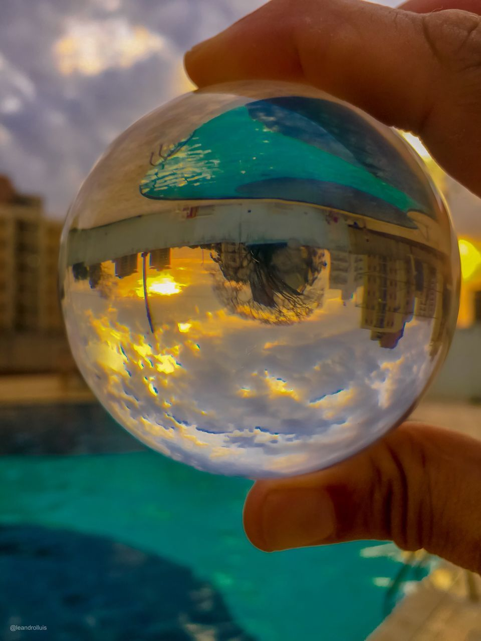 hand, one person, human hand, human body part, holding, real people, transparent, sphere, glass - material, close-up, finger, lifestyles, unrecognizable person, body part, human finger, focus on foreground, leisure activity, nature, reflection, outdoors, glass, human limb