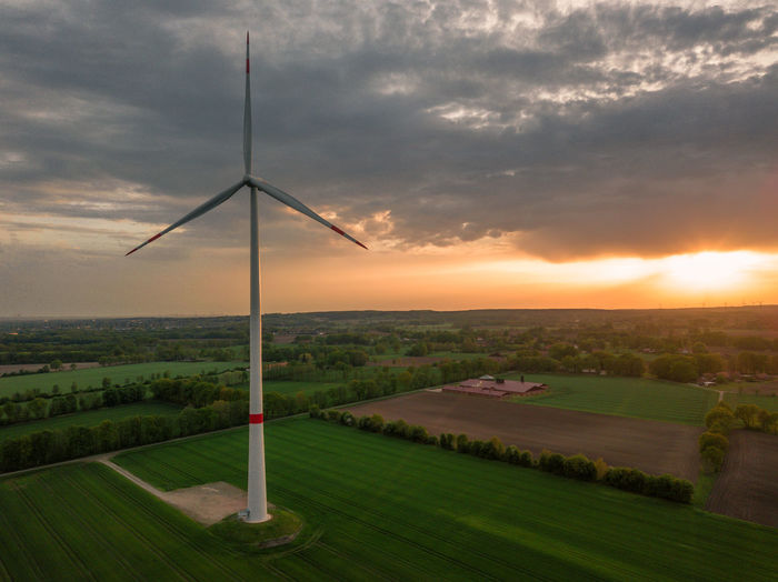 Drone  Nature Sunlight Wind Turbine Cloud - Sky Dronephotography Dynamic Dynamiclight Environment Field Grass Green Color Land Landscape Nature Orange Color Outdoors Plant Sky Sun Sunset Tree Warm Windpower Windpowerplant