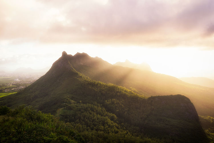 Mauritius mountains during sunset. Beauty In Nature Day Landscape Mauritius Mauritius Island  Mountain Mountain Range Nature No People Outdoors Peak Scenics Sky Sun Sunlight Sunset Tranquil Scene Tranquility Tree Lost In The Landscape