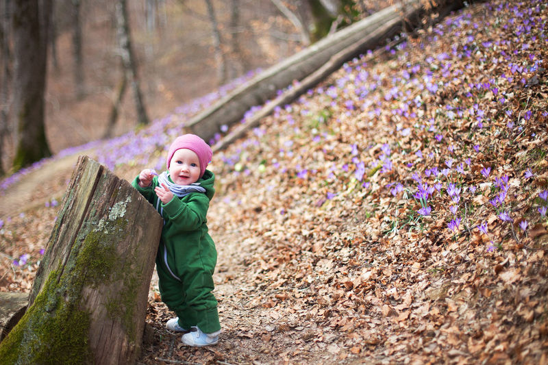 Full length of baby girl in forest