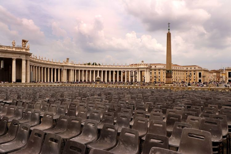Hundreds of seats are set out in preparation for crowds to view the Pope in St Peters Square, Vatican City, Rome, Italy Christianity Historical Building Travel Travel Photography Architectural Column Architecture Arts Culture And Entertainment Building Exterior Built Structure City Empty Seats Historical Place History In A Row No People Outdoors Roman Row Of Seats Seat Seats St Peters Square The Past Tourist Destination Travel Destination Vatican City