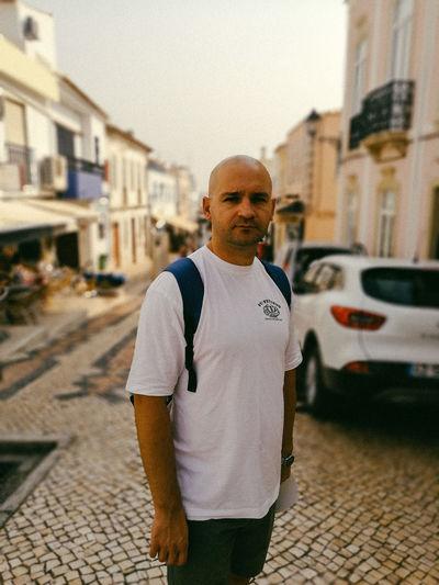 Portrait Of Bald Mid Adult Man Standing In City