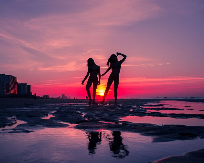 Purple Pink Color Bright Colors Sunrise Friendship Water Sky Sunset Sea Togetherness Two People Women Silhouette Beach Land Lifestyles Leisure Activity Nature Beauty In Nature Positive Emotion Friendship People