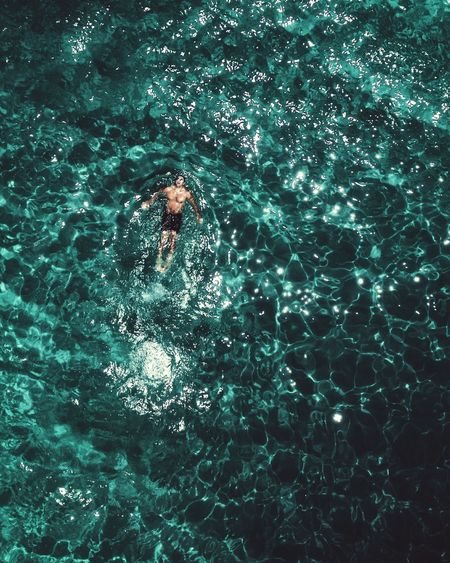 High angle view of man swimming on sea