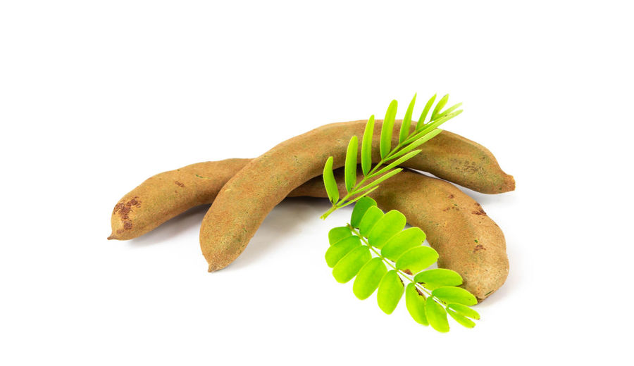 Fresh sweet tamarind isolated on white background ,with leaves Dessert Food And Drink Nutrition; Hot; Beverage; Weight; Organic; Taste; Aroma; Ardesia; Honeycomb; Studio; Pouring Asian; History; Spirituality Background; Basket; Beautiful; Beauty; Blossom; Bouquet; Bright; Bunch; Card; Decor; Decoration; Flowers; Fresh; Freshness; Gift; Green; Happy; Head; Holiday; Isolated; Leaf; Nature; Peaarl; Pink; Plant; Season; Spring; Tulips; White; Wicker; Brown Food Fresh; Food; Supermarket; Basket; Detox; Market; Isolated; Chrome; Pepper; Hand; Buy; White; Retail; Diet; Detoxification; Organic; Cabbage; Consumerism; Maize; Full; Selling; Garlic; Handle; Balanced; Vegetable; Consume; Broccoli; Tomato; Zucchini; Shopp Freshness; Fruit Group Healthy; Ingredient; Isolated; Leaf Organic; Raw; Portion; Red; Reflection; Refreshment; Pomegranate; Plate; Nutrition; Organic; Peel; Pieces; Ripe; Seeds; Vegetarian; Vitamin; Vivid; White; Tropical; Tasty; Sour; Studio; Sweet; Taste; Nobody; Nature; Dessert; Delicious; Diet; Dieting; Eat; Cut; Col Sweet Tamarind; Thai; Monastery; Province Tropical; Vegetable White;