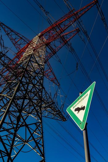 """Naturschutzgebiet"" EyeEmNewHere Low Angle View Communication Sign Sky No People Blue Day Nature Outdoors Electricity"