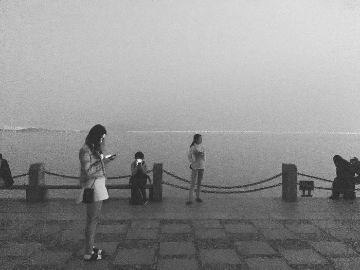 Shenzhen, China 2019 Mobilephotography IPhoneography VSCO Iphone6s Streetphotography Street Of China Blackandwhite Bay Evening Group Of People Water Sea Real People Beach Nature Leisure Activity Women Standing Outdoors