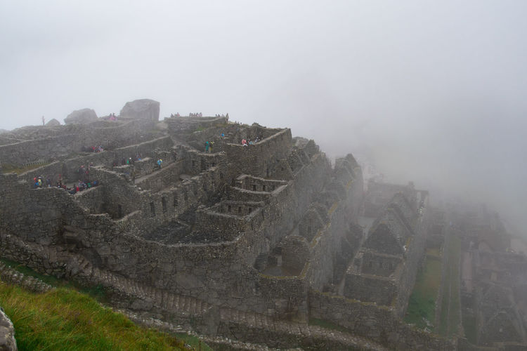 Fog Architecture History The Past Built Structure Nature Travel Destinations Ancient Ancient Civilization Building Exterior Sky Old Ruin Old No People Travel Day Fort Outdoors Archaeology Ruined Machu Picchu Inca Ruins Inca