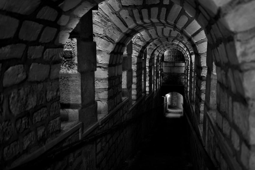 France Paris Arch Architecture Basement Black And White Collection  Black And White Friday Brick Wall Building Exterior Built Structure Catacombes De Paris Catacombs Day Historical History Indoors  Katakomben Keller One Person People Schwarzweiß